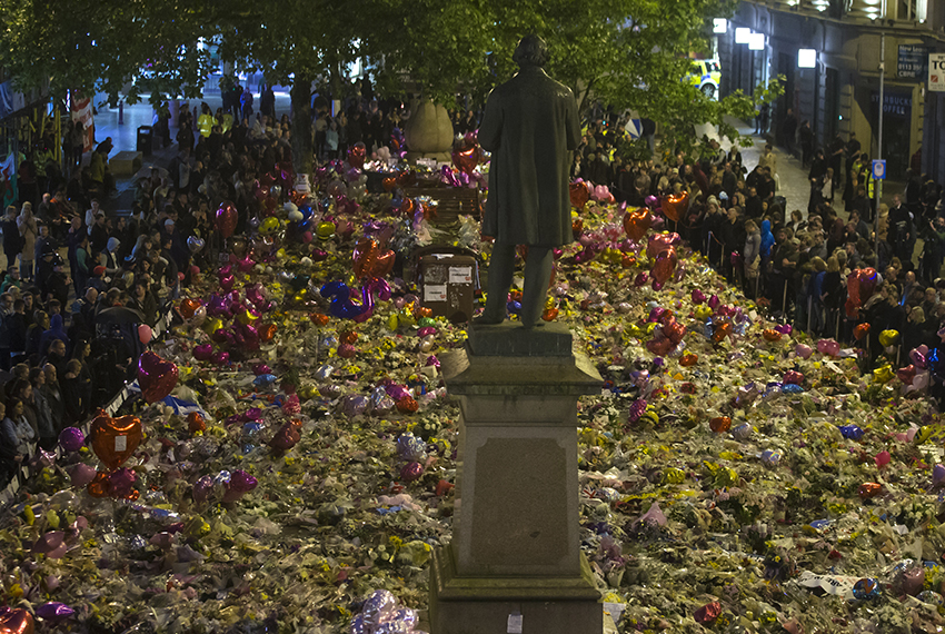 TOPSHOT - Members of the public take part in a vigil on St. Ann's Square in Manchester, northwest England on May 29, 2017, exactly one week after a bomb attack at Manchester Arena killed 22 and injured dozens more.  The attack, which has been claimed by the Islamic State jihadist group, targeted concertgoers at the end of a show by US teen pop idol Ariana Grande.  / AFP PHOTO / JON SUPER        (Photo credit should read JON SUPER/AFP/Getty Images)