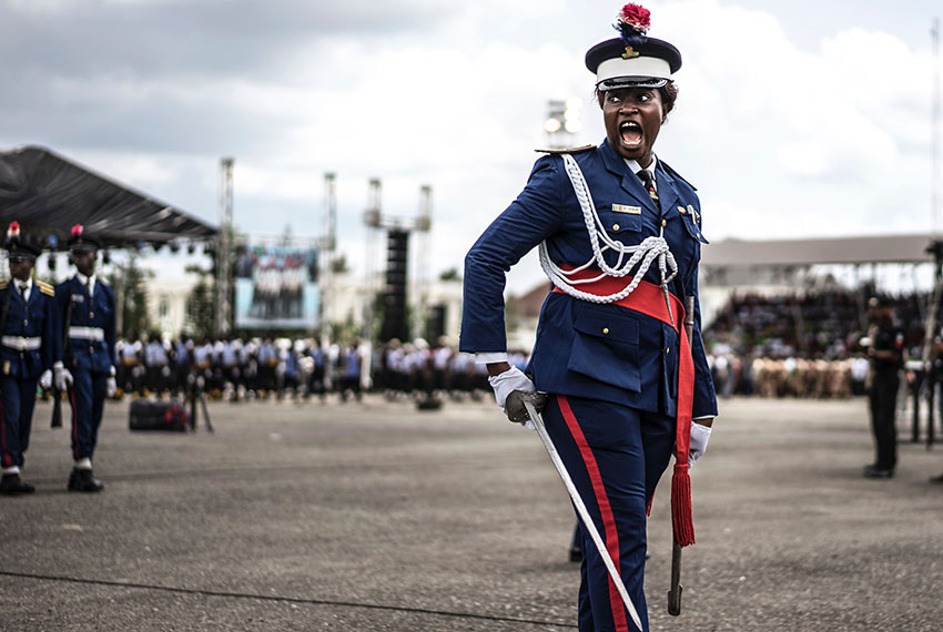 TOPSHOT - A Nigerian policewoman gives an order as she marches in front of authorities and members of the public during a Democracy Day parade on May 29, 2017 in Freedom Square in Owerri.  Democracy Day celebrates the end of military rules in Nigeria in May of 1999.  / AFP PHOTO / MARCO LONGARI        (Photo credit should read MARCO LONGARI/AFP/Getty Images)