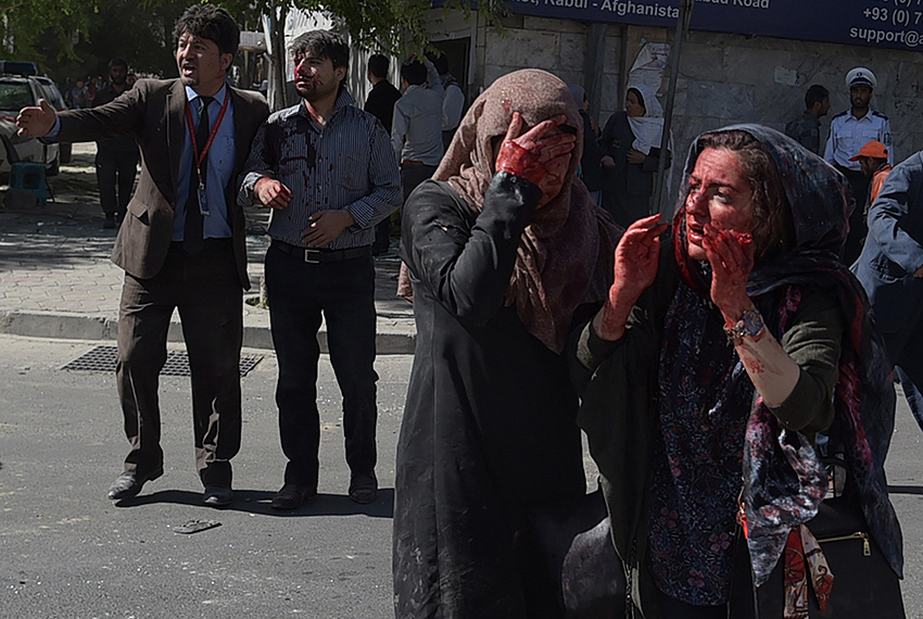 TOPSHOT - Wounded Afghan women and men gesture at the site of a car bomb attack in Kabul on May 31, 2017. At least 40 people were killed or wounded on May 31 as a massive blast ripped through Kabul's diplomatic quarter, shattering the morning rush hour and bringing carnage to the streets of the Afghan capital. / AFP PHOTO / SHAH MARAI        (Photo credit should read SHAH MARAI/AFP/Getty Images)