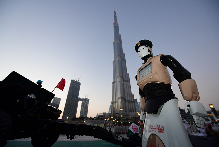 TOPSHOT - The world's first operational police robot stands at attention as they prepare a military cannon to fire to mark sunset and the end of the fasting day for Muslims observing Ramadan, in Downtown Dubai on May 31, 2017. / AFP PHOTO / GIUSEPPE CACACE        (Photo credit should read GIUSEPPE CACACE/AFP/Getty Images)