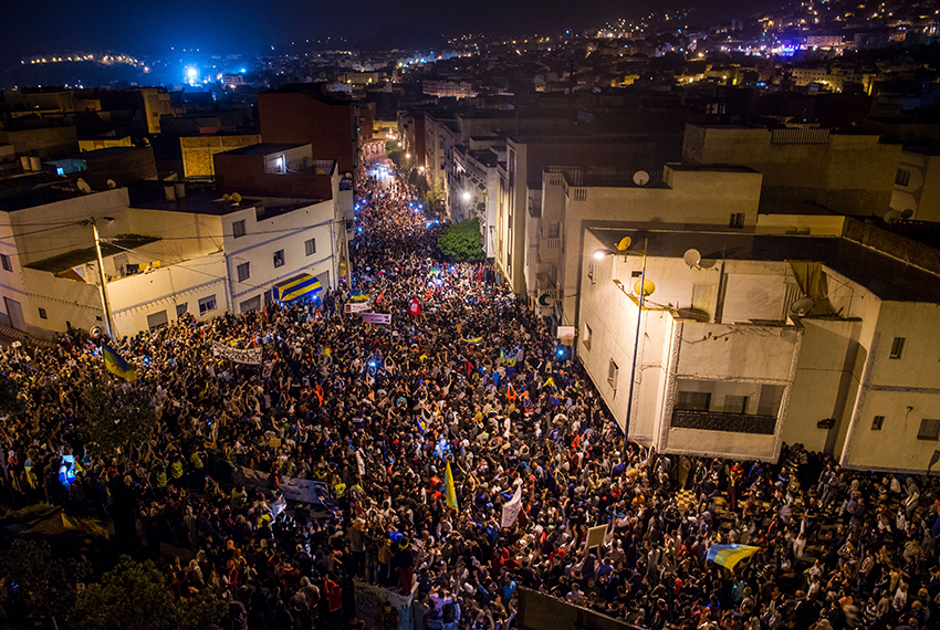 """TOPSHOT - Thousands of protestors crowd the steets of the northern Moroccan city of Al-Hoceima, during a demonstration demanding the release of Nasser Zefzafi, head of the grassroots Al-Hirak al-Shaabi, or """"Popular Movement"""" on May 31, 2017. Thousands staged demonstrations for a fifth night running in northern Morocco to demand the release of the leader of a months-long protest movement in the neglected Rif region.  The region has been shaken by social unrest since the death in October of fishmonger Mouhcine Fikri, 31, who was crushed in a rubbish truck in the fishing port of Al-Hoceima as he protested against the seizure of swordfish caught out of season.  / AFP PHOTO / FADEL SENNA        (Photo credit should read FADEL SENNA/AFP/Getty Images)"""