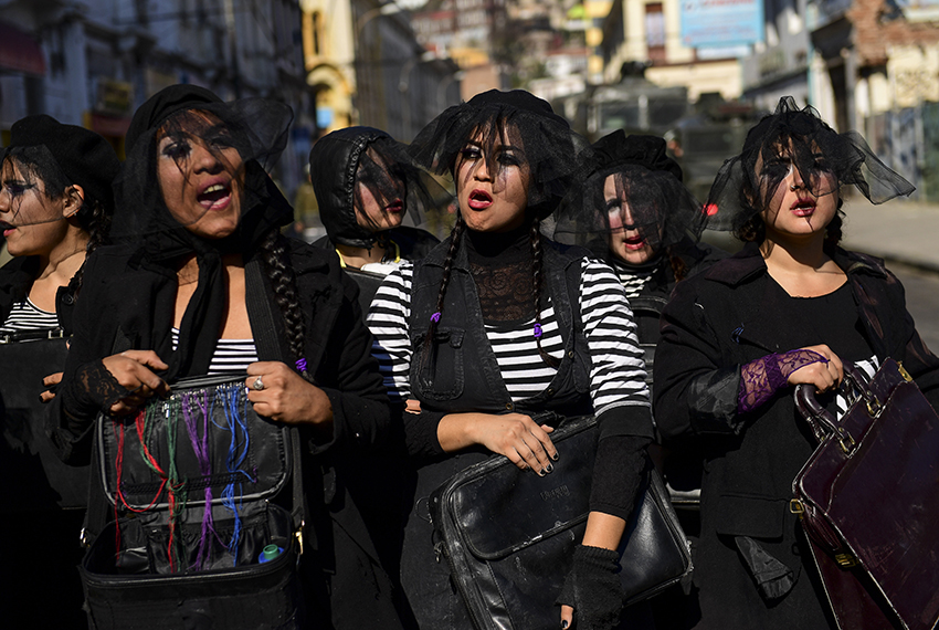 TOPSHOT - Students demonstrate near the Congress as Chilean President Michelle Bachelet delivers her annual message in Valparaiso, Chile, on June 1, 2017. / AFP PHOTO / Martin BERNETTI        (Photo credit should read MARTIN BERNETTI/AFP/Getty Images)