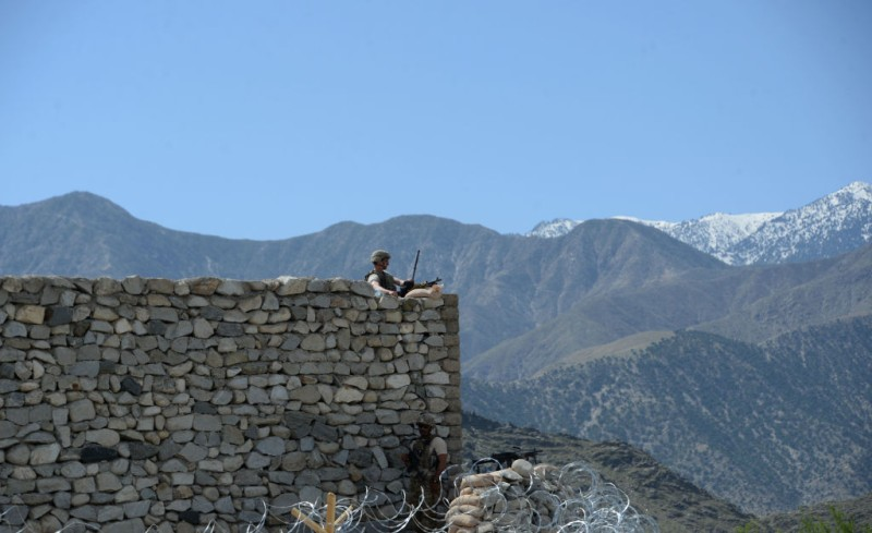 "A US soldier stands guard near the site of a US bombing during an operation against Islamic State (IS) militants in the Achin district of Nangarhar province on April 15, 2017. Afghan authorities April 15 reported a jump in fatalities from the American military's largest non-nuclear bomb, declaring some 90 Islamic State fighters dead, as US-led forces conducted clean-up operations over their mountain hideouts. Dubbed the ""Mother Of All Bombs"", the GBU-43/B Massive Ordnance Air Blast was unleashed in combat for the first time April 12, hitting IS positions in a remote area of eastern Nangarhar province. / AFP PHOTO / NOORULLAH SHIRZADA        (Photo credit should read NOORULLAH SHIRZADA/AFP/Getty Images)"