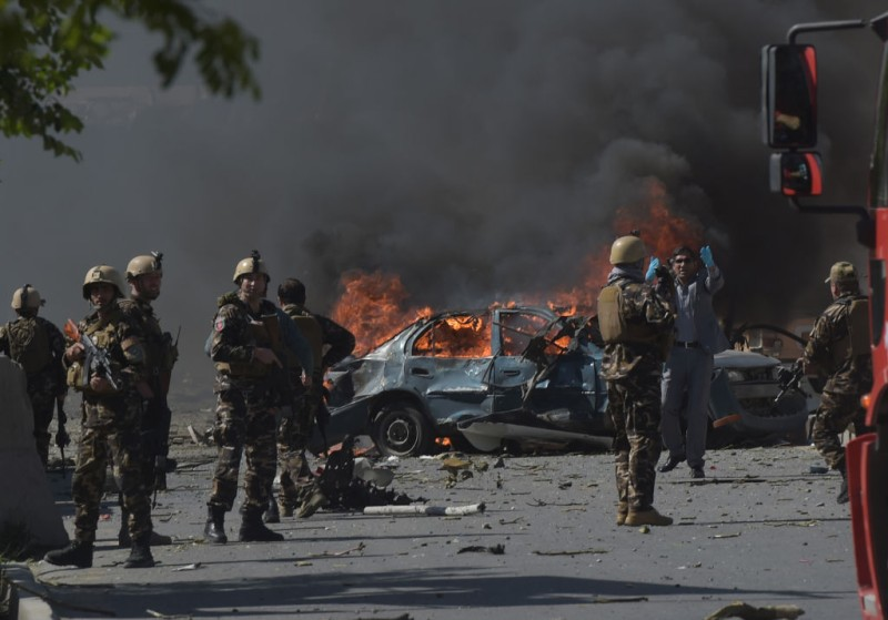 Afghan security forces personnel are seen at the site of a car bomb attack in Kabul on May 31, 2017. At least 40 people were killed or wounded on May 31 as a massive blast ripped through Kabul's diplomatic quarter, shattering the morning rush hour and bringing carnage to the streets of the Afghan capital. / AFP PHOTO / SHAH MARAI        (Photo credit should read SHAH MARAI/AFP/Getty Images)