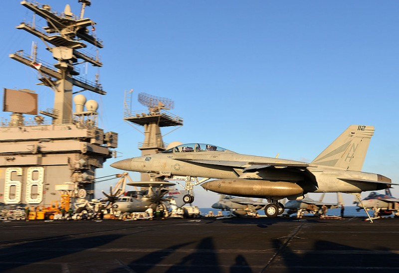 An F/A-18E Super Hornet lands on the flight deck of the US navy's supercarrier USS Nimitz (CVN 68) in the Mediterranean Sea on October 24, 2013. The US aircraft carrier is on standby in case of a flare up in Syria and left the Red Sea for a brief stint in the  Mediterranean Sea. AFP PHOTO / ALBERTO PIZZOLI        (Photo credit should read ALBERTO PIZZOLI/AFP/Getty Images)