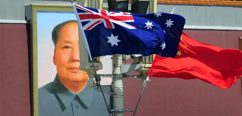 The national flags of Australia and China are displayed before a portrait of Mao Zedong facing Tiananmen Square, during a visit by Australia's Prime Minister Julia Gillard in Beijing on April 26, 2011. The trip is Gillard's first to China, Australia's top trading partner, and comes at a time when the communist country is waging its toughest crackdown on dissent in years. AFP PHOTO/Frederic J. BROWN (Photo credit should read FREDERIC J. BROWN/AFP/Getty Images)