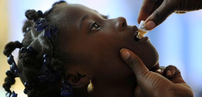 A child receives the second dose of the vaccine against cholera in Saut d'Eau, in the Central Plateau of Haiti, on 17 September 2014. The UN has launched its second phase of the vaccinationcampaign against cholera which was initiated and implemented by the Haitian authorities as part of the broader framework of the national plan for the elimination of cholera in the country. The campaign aims to vaccinate 200,000 people living in the communes where the disease persists in particular the department of Artibonite, Central and West.  AFP PHOTO/Hector RETAMAL        (Photo credit should read HECTOR RETAMAL/AFP/Getty Images)