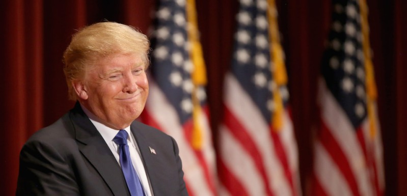 DES MOINES, IA - JANUARY 28:  Republican presidential candidate Donald Trump smiles as he speaks to veterans at Drake University on January 28, 2016 in Des Moines, Iowa. Donald Trump held his alternative event to benefit veterans after withdrawing from the televised Fox News/Google  GOP debate  which airs at the same time.  (Photo by Christopher Furlong/Getty Images)