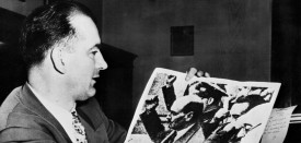 WASHINGTON, :  US Senator Joseph McCarthy holds a picture showing Clement Richard Attlee, British statesman and Prime minister (1945-1951) making a communist salute during the Spanish civil war. John Parnell Thomas and MacCarthy instigated an anti-commnist witchhunt campaign in the early 1950's, a period known as McCarthyism. In 1953 he became chairman of the powerful Permanent Subcommittee on Investigations. He was formally condemned by the Senate in 1954 lost power and died in 1957. (Photo credit should read AFP/AFP/Getty Images)