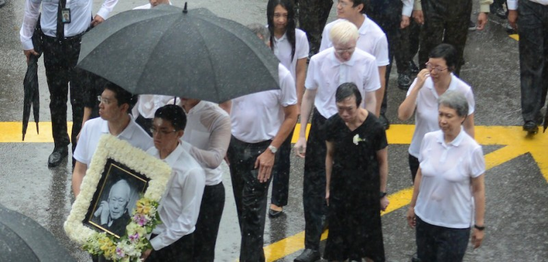 This photograph taken on March 29, 2015 shows Lee Wei Ling (2nd R), the younger sister of Singapore's Prime Minister Lee Hsien Loong, along with family members walking out of parliament house during the late founding father Lee Kuan Yew's funeral procession in Singapore.  Singapore Prime Minister Lee Hsien Loong on April 10, 2016 denied abusing his power and attempting to establish a dynasty as a family feud went public after the first anniversary of the death of his father Lee Kuan Yew.  / AFP / MOHD FYROL        (Photo credit should read MOHD FYROL/AFP/Getty Images)