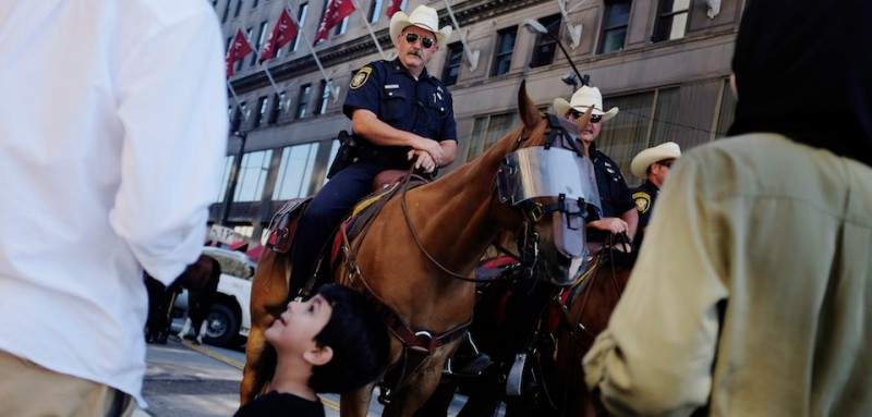 TOPSHOT - A young boy and his family look at the horses of the Fort Worth, Texas mounted police on the third day of the Republican National Convention on July 20, 2016, in Cleveland, Ohio. / AFP / DOMINICK REUTER        (Photo credit should read DOMINICK REUTER/AFP/Getty Images)