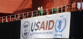 A general view shows a Sudanes worker sitting on the USA flagged bulk carrier, Liberty Glory, docked in Port Sudan on October 17, 2016 as the World Food Programme delivers US aid.     / AFP / ASHRAF SHAZLY        (Photo credit should read ASHRAF SHAZLY/AFP/Getty Images)