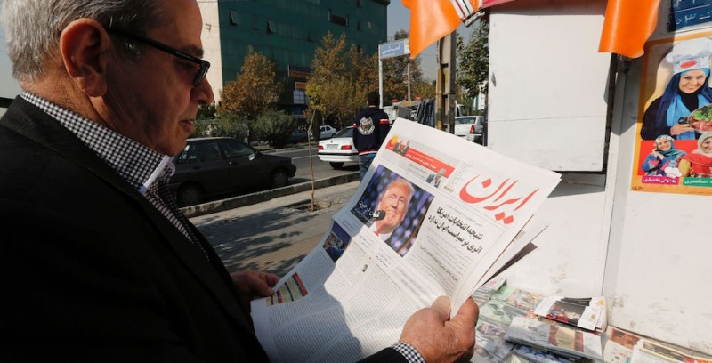 "An Iranian man holds a local newspaper displaying a portrait of Donald Trump a day after his election as the new US president, in the capital Tehran, on November 10, 2016. Iran's President Hassan Rouhani said on November 9 there was ""no possibility"" of its nuclear deal with world powers being overturned by US president-elect Donald Trump despite his threat to rip it up.   / AFP / ATTA KENARE        (Photo credit should read ATTA KENARE/AFP/Getty Images)"