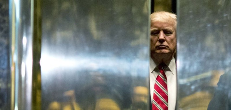 TOPSHOT - US President-elect Donald Trump boards the elevator after escorting Martin Luther King III to the lobby after meetings at Trump Tower in New York City on January 16, 2017.  / AFP / DOMINICK REUTER        (Photo credit should read DOMINICK REUTER/AFP/Getty Images)