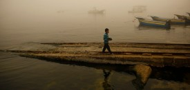 TOPSHOT - A Palestinian boy walks along the sea during a foggy day in Gaza City on February 26, 2017. / AFP PHOTO / MOHAMMED ABED        (Photo credit should read MOHAMMED ABED/AFP/Getty Images)