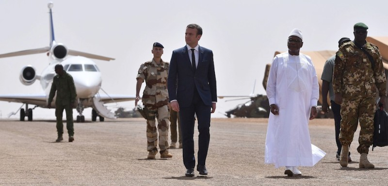 French President Emmanuel Macron (C) and Mali's President Ibrahim Boubacar Keita (2-R) review troops during a visit to France's Barkhane counter-terrorism operation in Africa's Sahel region in Gao, northern Mali, on May 19, 2017.  French President's visit in Mali is his first trip outside Europe since his inauguration on May 14, 2017. / AFP PHOTO / POOL / CHRISTOPHE PETIT TESSON        (Photo credit should read CHRISTOPHE PETIT TESSON/AFP/Getty Images)