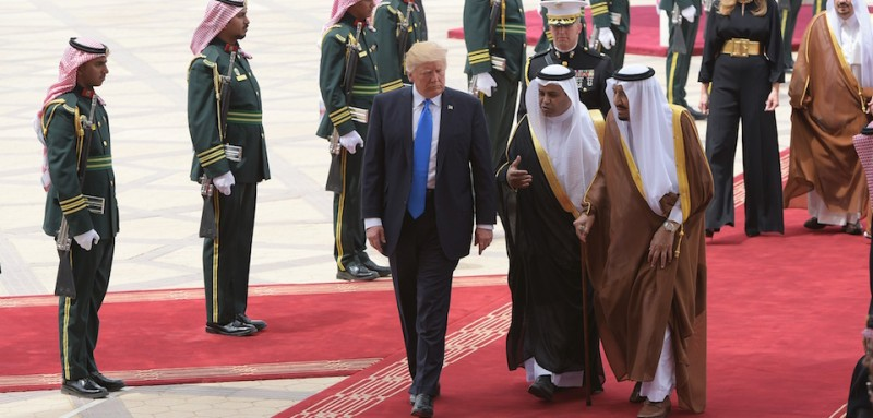 US President Donald Trump (C) is welcomed by Saudi King Salman bin Abdulaziz al-Saud (3rd-R) upon arrival at King Khalid International Airport in Riyadh on May 20, 2017, followed by First Lady Melania Trump (2nd-R). / AFP PHOTO / MANDEL NGAN        (Photo credit should read MANDEL NGAN/AFP/Getty Images)