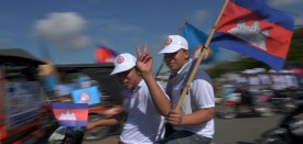 Supporter of Cambodian People Party (CPP) ride their motorbikes during the Commune Election Campaign in Phnom Penh on May 21, 2017. Tuk-tuks blaring pop music and flag-waving party faithful on Saturday led a rally by Cambodia's embattled opposition for upcoming commune elections, a bellwether for efforts to end the three-decade rule of strongman Hun Sen in next year's national polls. / AFP PHOTO / TANG CHHIN SOTHY        (Photo credit should read TANG CHHIN SOTHY/AFP/Getty Images)