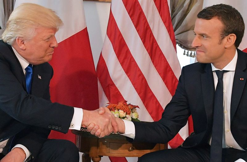 US President Donald Trump (L) and French President Emmanuel Macron (R) shake hands ahead of a working lunch, at the US ambassador's residence, on the sidelines of the NATO (North Atlantic Treaty Organization) summit, in Brussels, on May 25, 2017. / AFP PHOTO / Mandel NGAN        (Photo credit should read MANDEL NGAN/AFP/Getty Images)