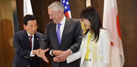 South Korea's Defense Minister Han Min-Koo (L) shows US Pentagon chief Jim Mattis (C) how to pose for a tri-handshake, as Japan's Defence Minister Tomomi Inada looks on, during a trilateral meeting on the sidelines of the 16th Institute for Strategic Studies (IISS) Shangri-La Dialogue Summit in Singapore on June 3, 2017.  The annual Shangri-La Dialogue is attended by defence ministers from around the region and runs from June 2 to 4. / AFP PHOTO / Roslan RAHMAN        (Photo credit should read ROSLAN RAHMAN/AFP/Getty Images)
