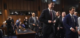 Former FBI Director James Comey leaves after testifying before the US Senate Select Committee on Intelligence hearing on Capitol Hill in Washington, DC, June 8, 2017. / AFP PHOTO / SAUL LOEB        (Photo credit should read SAUL LOEB/AFP/Getty Images)
