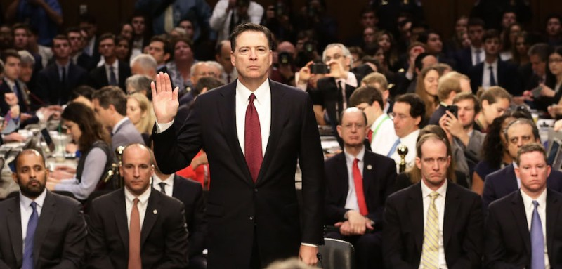 WASHINGTON, DC - JUNE 08:  Former FBI Director James Comey is sworn-in before testifing before the Senate Intelligence Committee in the Hart Senate Office Building on Capitol Hill June 8, 2017 in Washington, DC. Comey said that President Donald Trump pressured him to drop the FBI's investigation into former National Security Advisor Michael Flynn and demanded Comey's loyalty during the one-on-one meetings he had with president.  (Photo by Mark Wilson/Getty Images)