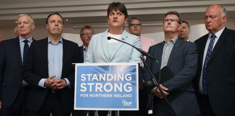 BELFAST, NORTHERN IRELAND - JUNE 09: DUP leader and Northern Ireland former First Minister Arlene Foster (C) holds a brief press conference with the DUP's newly elected Westminster candidates who stood in the general election on June 9, 2017 in Belfast, Northern Ireland. After a snap election was called by Prime Minister Theresa May the United Kingdom went to the polls yesterday. The closely fought election has failed to return a clear overall majority winner and a hung parliament has been declared. Arlene Foster and the Democratic Unionist party with their ten Westminster seats have today stated that they will back Theresa May and the Conservatives in a prop up goverment. The two parties will continue talks about the finer details of the arrangement. (Photo by Charles McQuillan/Getty Images)