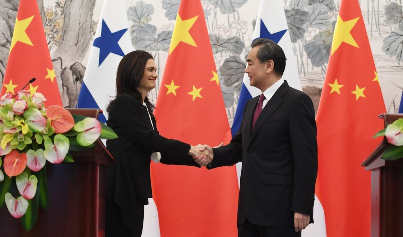 Panama's Vice President and Foreign Minister Isabel de Saint Malo (L) shakes hands with Chinese Foreign Minister Wang Yi during a joint press briefing after they signed a joint communique agreeing to establish diplomatic relations in Beijing on June 13, 2017. Panama and China announced June 13 they were establishing diplomatic relations, as the Central American nation became the latest to dump Taiwan for closer ties with the world's second-largest economy. / AFP PHOTO / POOL / GREG BAKER        (Photo credit should read GREG BAKER/AFP/Getty Images)