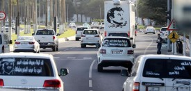 """A general view taken on June 11, 2017 shows portraits of Qatar's Emir Sheikh Tamim bin Hamad Al-Thani on the back of vehicles and text reading in Arabic: """"Tamim the glorious"""" in Doha after the diplomatic crisis surrounding Qatar and the other Gulf countries spilled from social media to more traditional forms of media -- all the way back to billboards.  The diplomatic crisis surrounding Qatar and other Gulf countries has remained a peaceful one for now, but open warfare has been declared in the media -- both traditional and social. / AFP PHOTO / KARIM JAAFAR        (Photo credit should read KARIM JAAFAR/AFP/Getty Images)"""