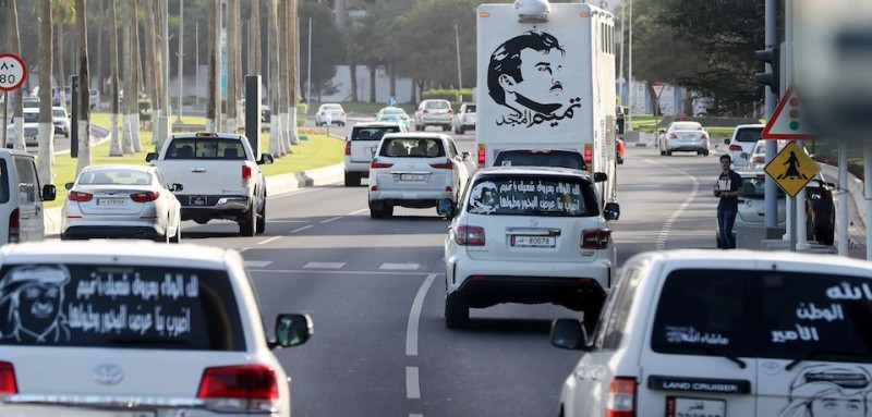 "A general view taken on June 11, 2017 shows portraits of Qatar's Emir Sheikh Tamim bin Hamad Al-Thani on the back of vehicles and text reading in Arabic: ""Tamim the glorious"" in Doha after the diplomatic crisis surrounding Qatar and the other Gulf countries spilled from social media to more traditional forms of media -- all the way back to billboards.  The diplomatic crisis surrounding Qatar and other Gulf countries has remained a peaceful one for now, but open warfare has been declared in the media -- both traditional and social. / AFP PHOTO / KARIM JAAFAR        (Photo credit should read KARIM JAAFAR/AFP/Getty Images)"