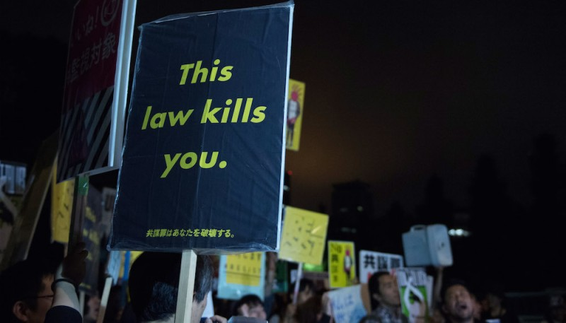 TOKYO, JAPAN - JUNE 15:  People protest outside the National Diet on June 15, 2017 in Tokyo, Japan. Japan's controversial anti-conspiracy bill, to crack down on people planning terrorism and other organised crimes, is under debate in the upper house while there are concerns that it threatens civil rights.  Prime Minister Abe's LDP and its allies have a two-thirds majority in both the upper house, and the lower house, where the bill was passed in late May.  (Photo by Takashi Aoyama/Getty Images)