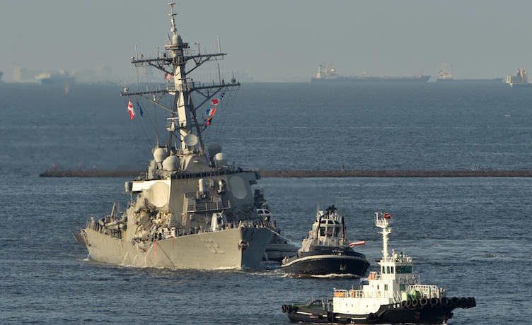 US Navy guided missile destroyer USS Fitzgerald arrves at its mother port US Naval Yokosuka Base, Kanagawa prefecture on June 17, 2017.  The US and Japan launched a major search operation to find seven missing American sailors on June 17 after their navy destroyer collided with a container ship, crushing the side of the military vessel. / AFP PHOTO / Kazuhiro NOGI        (Photo credit should read KAZUHIRO NOGI/AFP/Getty Images)
