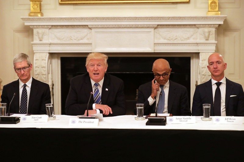 """WASHINGTON, DC - JUNE 19:  U.S. President Donald Trump (2nd L) welcomes members of his American Technology Council, including (L-R) Apple CEO Tim Cook, Microsoft CEO Satya Nadella and Amazon CEO Jeff Bezos in the State Dining Room of the White House June 19, 2017 in Washington, DC. According to the White House, the council's goal is """"to explore how to transform and modernize government information technology.""""  (Photo by Chip Somodevilla/Getty Images)"""