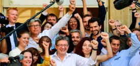 La France Insoumise (LFI) leftist party's members of parliament, party leader Jean-Luc Melenchon (Front L), Eric Coquerel (2ndL Rear), Daniele Obono (4thL), Alexis Corbiere (6thL), Adrien Quatennens (Top L), Ugo Bernalicis (7thL Rear), Sabine Rubin (2ndL), Francois Ruffin (3rdR), Bastien Lachaud (8thL), Caroline Fiat (L), Mathilde Pano (Second Row, L), Benedicte Taurine (4th L Front) and Loic Prudhomme (2ndR) pose after they arrived at the French National Assembly on June 20, 2017 in Paris for the welcoming of the elected MPs following the announcement of the results of the second round of the French parliamentary elections (elections legislatives in French).  / AFP PHOTO / Martin BUREAU        (Photo credit should read MARTIN BUREAU/AFP/Getty Images)