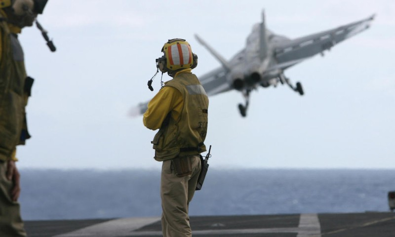 """TO GO WITH INDIA-US-JAPAN-SINGAPORE-AUSTRALIA-MILITARY  In this picture taken 07 September 2007, a US F-18 fighter plane takes off from the deck of USS Kitty Hawk (CV63) aircraft carrier in the Bay of Bengal, during the Malabar exercise.   A massive peacetime military exercise ended in the Indian Ocean 09 September, as navies from five nations including the United States disengaged from mock battles, officials said. The USS Nimitz, the world's largest supercarrier, had already withdrawn from the Bay of Bengal where besides the United States, navies from Australia, India Japan and Singapore launched the drill on 04 September.The end of the six-day exercises, code named """"Operation Malabar"""" was marked by mock battles involving fighter jets from supercarrier the USS Kitty Hawk and India's aircraft carrier INS Viraat and other strike groups near the strategic Malacca Straits, they said.    AFP PHOTO/Deshakalyan CHOWDHURY (Photo credit should read DESHAKALYAN CHOWDHURY/AFP/Getty Images)"""