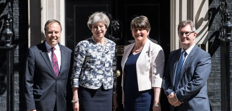 LONDON, ENGLAND - JUNE 26: Britain's Prime Minister, Theresa May (C-L), greets Arlene Foster, the leader of Northern Ireland's Democratic Unionist Party (C-R), deputy leader of the Democratic Unionist Party, Nigel Dodds (L) and DUP MP Jeffrey Donaldson (R) as they arrive in Downing Street on June 26, 2017 in London, England. Mrs Foster has said a deal between her party and the Conservatives to support a minority government is close. (Photo by Carl Court/Getty Images)