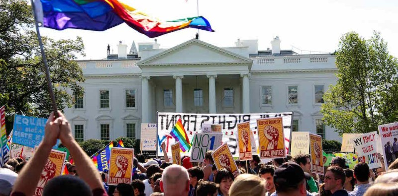 Demonstrators  wave flags and banners in front of the White House in Washington on October 11, 2009 as tens of thousands of gay activists marched to demand civil rights, a day after President Barack Obama vowed to repeal a ban on gays serving openly in the US military.        AFP PHOTO/Maria Belen PEREZ GABILONDO (Photo credit should read Maria Belen Perez Gabilondo/AFP/Getty Images)