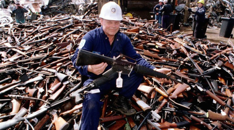 TO GO WITH US-shooting-guns-Australia,FOCUS by Martin Parry (FILES) This file photo taken on September 8, 1996 shows Norm Legg, a project supervisor with a local security firm, holding up an armalite rifle which is similar to the one used in the Port Arthur massacre and which was handed in for scrap in Melbourne after Australia banned all automatic and semi-automatic rifles in the aftermath of the Port Arthur shooting. When Martin Bryant massacred 35 people with semi-automatic weapons at Port Arthur in 1996, then-Australian prime minister John Howard reacted swiftly by pushing for tough new national gun laws. Within a year gun licences had been tightened, a weapons buy-back was enacted and an amnesty launched for anyone holding illegal arms, moves that took more than 600,000 guns out of action.     AFP PHOTO / FILES /  William WEST        (Photo credit should read WILLIAM WEST/AFP/Getty Images)