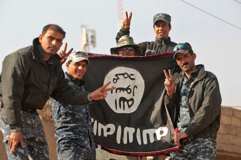 Iraqi soldiers display a captured flag of the Islamic State in the Hamam al-Alil area, about 14 kilometres from the southern outskirts of Mosul, on November 7, 2016 after recapturing it from Islamic State (IS) group jihadists during the ongoing operation to retake Mosul.  Iraqi forces retook a key town from the Islamic State group, a crucial objective on the southern front of the offensive to wrest back the city of Mosul.   / AFP / AHMAD AL-RUBAYE        (Photo credit should read AHMAD AL-RUBAYE/AFP/Getty Images)