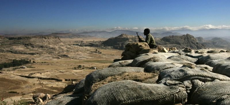 "ZALA ANBESSA, ETHIOPIA:  An Ethiopian soldier mans an observation post facing the Temporary Security Zone on the Eritrean border at the northern town of Zala Anbessa in the Tigray region of Ethiopia, 19 November 2005. The United Nations mission to the Horn of Africa on Friday reported increasing movement of troops along the tense border between Ethiopia and Eritrea. UN Mission spokeswoman Gail Bindley-Taylor-Sainte said the situation along the frontier ""remains tense and potentially volatile."" AFP PHOTO/MARCO LONGARI  (Photo credit should read MARCO LONGARI/AFP/Getty Images)"