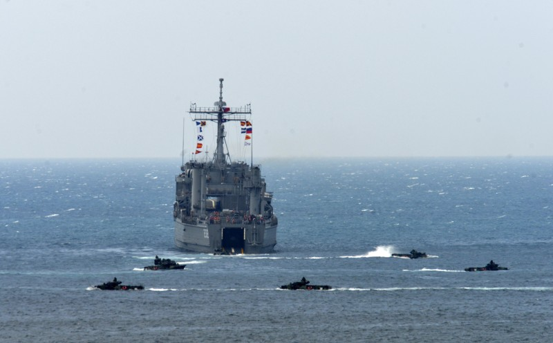 """A landing ship is surrounded by the amphibious assault vehicles during the """"Han Kuang"""" (Han Glory) life-fire drill, some 7 kms (4 miles) from the city of Magong on the outlying Penghu islands on May 25, 2017. Taiwan forces conducted live-fire war games in its biggest annual military exercise on May 25, presided by President Tsai Ing-wen, as the island faces growing threat from its cross-strait rival China. / AFP PHOTO / SAM YEH        (Photo credit should read SAM YEH/AFP/Getty Images)"""