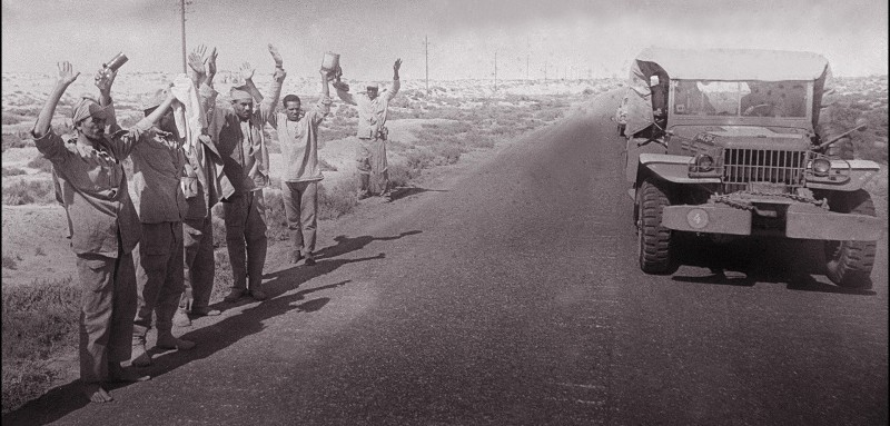 Arab soldiers surrender to Israeli soldiers 13 June 1967 in the occupied territory of the West Bank.  On 05 June 1967, Israel launched preemptive attacks against Egypt and Syria. In just six days, Israel occupied the Gaza Strip and the Sinai peninsula of Egypt, the Golan Heights of Syria, and the West Bank and Arab sector of East Jerusalem (both under Jordanian rule), thereby giving the conflict the name of the Six-Day War. / AFP / PIERRE GUILLAUD        (Photo credit should read PIERRE GUILLAUD/AFP/Getty Images)