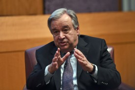 """United Nations Secretary-General Antonio Guterres speaks on climate change at the New York University Stern School of Business, in New York on May 30, 2017.  Guterres said it was """"absolutely essential"""" that the Paris climate agreement be implemented, as the US weighed pulling out of the emissions-cutting deal. In his first major address on climate, Guterres said the world must fulfill the commitments of the 2015 agreement """"with increased ambition.""""  / AFP PHOTO / JEWEL SAMAD        (Photo credit should read JEWEL SAMAD/AFP/Getty Images)"""
