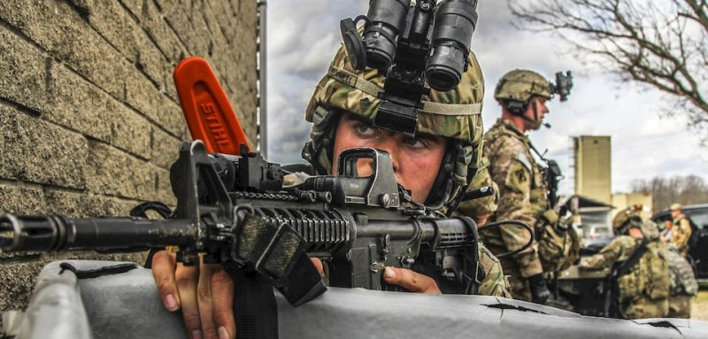 Paratrooper assumes a security position during a tactical exercise