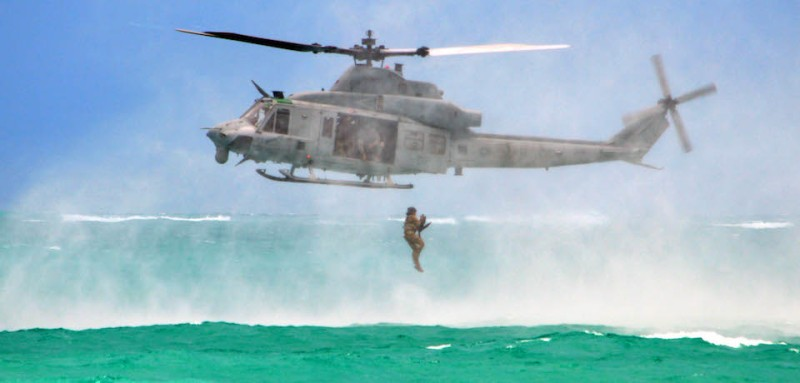 "A Soldier assigned to 3rd Squadron, 4th Cavalry Regiment, 3rd Brigade Combat Team, 25th Infantry Division, conducts a helocast insertion into the Pacific Ocean near Marine Corps Training Area Bellows, Hawaii, on May 16, 2017. A UH-1Y ""Super Huey"" helicopter assigned to the Marine Light Attack Helicopter Squadron 367 provided aerial support for the Soldiers. (U.S. Army photo by Staff Sgt. Armando R. Limon, 3rd Brigade Combat Team, 25th Infantry Division)"