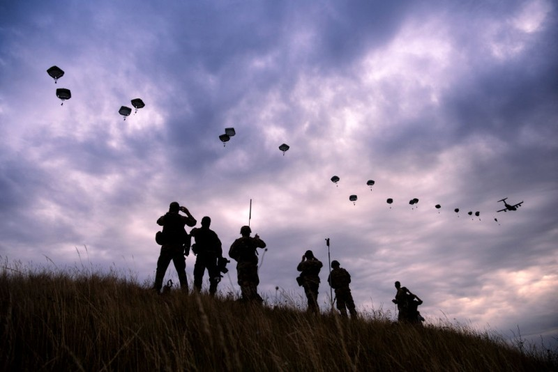 NATO paratroopers drop out of a US Air Force Hercules during the 'Swift Response 17' joint airborn military exercise at Bezmer airfield near the village of Bezmer on July 18, 2017.  The US led 'Swift Response 17' airborne exercise, part of the multinational 'Saber Guardian 2017' exercise, involves up to 1,600 soldiers from the United States, Canada, Italy, Portugal and Greece. / AFP PHOTO / Dimitar DILKOFF        (Photo credit should read DIMITAR DILKOFF/AFP/Getty Images)