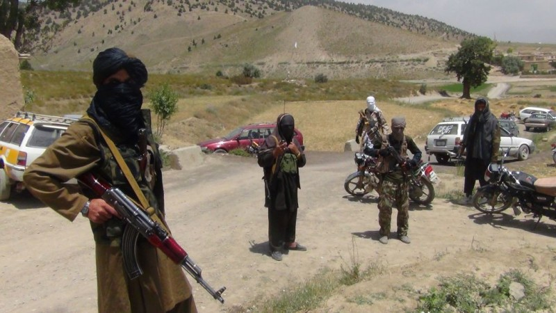 Fighters with Afghanistan's Taliban militia stand with their weapons in Ahmad Aba district on the outskirts of Gardez, the capital of Paktia province, on July 18, 2017. Civilian deaths in Afghanistan hit a new high in the first half of 2017 with 1,662 killed and more than 3,500 injured, the United Nations said July 17. The majority of the victims were killed by anti-government forces -- including the Taliban and in attacks claimed by the Islamic State, the report said.   / AFP PHOTO / FARIDULLAH AHMADZAI        (Photo credit should read FARIDULLAH AHMADZAI/AFP/Getty Images)