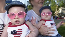 TWINSBURG, OH - AUGUST 3:   Twins Gabriella and Isabella Belsito, 7-mos-old, prepare to take part in the Double Take Parade August 3, 2002 at the Twins Days Festival in Twinsburg, Ohio.  (Photo by Mike Simons/Getty Images)