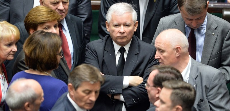 Jaroslaw Kaczynski, leader of Poland's opposition conservative party Law and Justice (PiS) (C), stands by to his lawmakers during a voting session at the parliamentary chamber on July 11, 2014 in Warsaw as the Prime Minister won a second confidence vote in as many weeks as the country's opposition sought to force his centre-right government to resign over a high-profile eavesdropping scandal. Interior Minister Bartlomiej Sienkiewicz, who is implicated in the scandal, also survived an opposition bid to topple him and Prime minister Donald Tusk in voting. The high-pitched controversy erupted in mid-June with the leaks of juicy exchanges between senior government officials. AFP PHOTO/JANEK SKARZYNSKI        (Photo credit should read JANEK SKARZYNSKI/AFP/Getty Images)