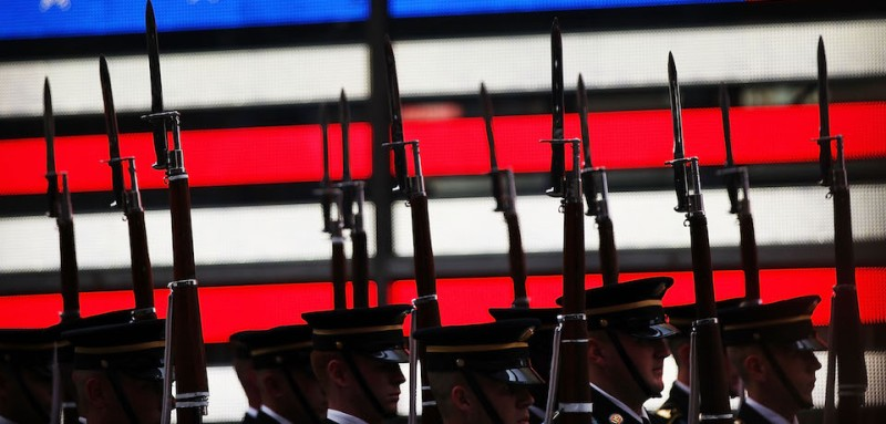 "NEW YORK, NY - JUNE 12: Members of the U.S. Army Drill Team perform in Times Square in New York City in honor of the Army's 240th birthday on June 12, 2015 in New York City. Soldiers from the 3rd U.S. Infantry Regiment, the U.S. Army Old Guard Fife and Drum Corps, Soldier-musicians from The U.S. Army Band ""Pershing's Own"" Downrange, and the U.S. Military Academy West Point Band entertained and gave demonstrations to the crowds in the historic center of Manhattan. (Photo by Spencer Platt/Getty Images)"